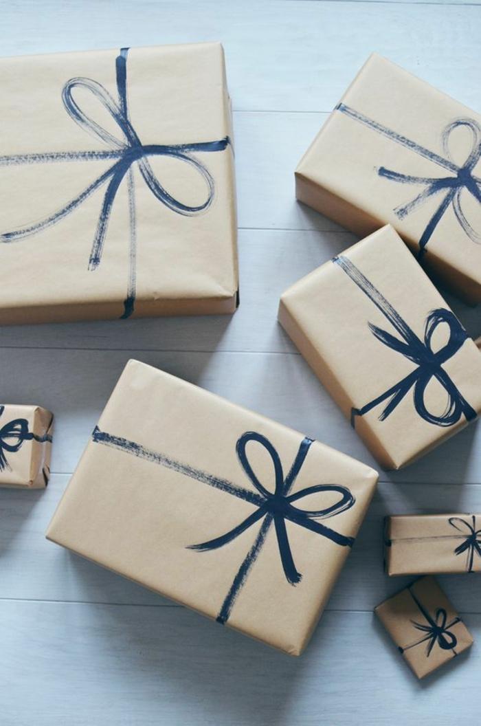 decorar papel embalaje con pintura acrílica en color negro, lazos dibujados, ideas para envolver regalos de forma original