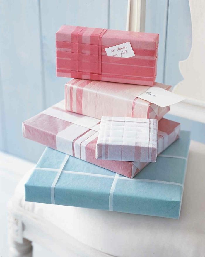 regalos envueltos en colores pastel con cinta decorativa color blanco y rojo, bonitas ideas como hacer una caja de papel