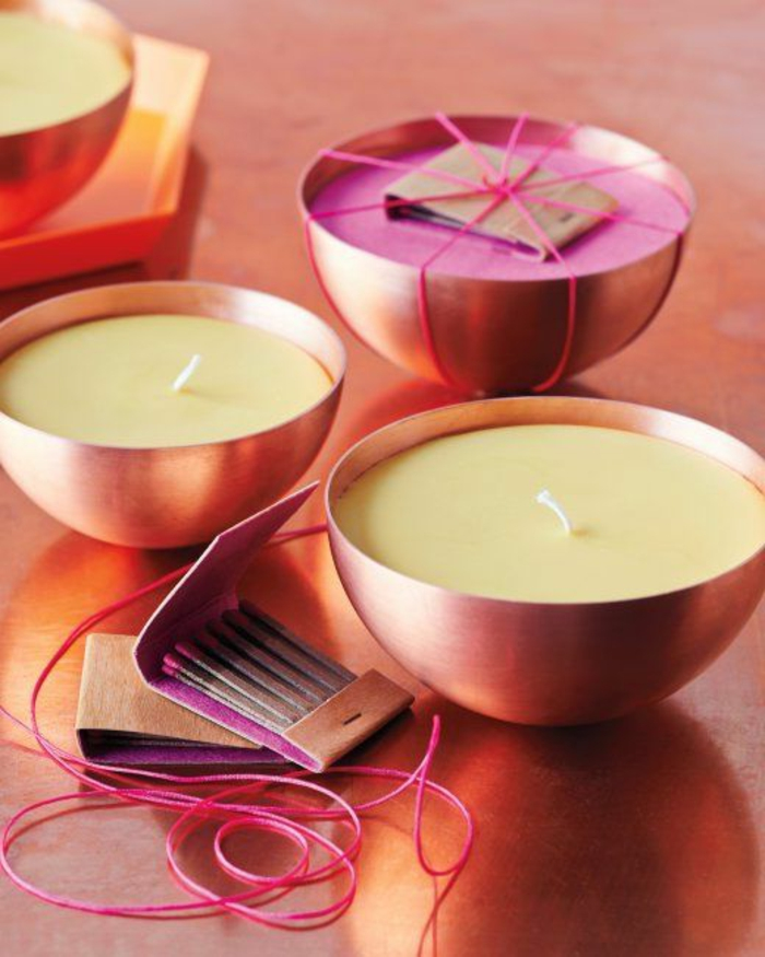 maravillosas propuestas de velas caseras, decoración mesa con velas hechas a mano en color amarillo y rosado