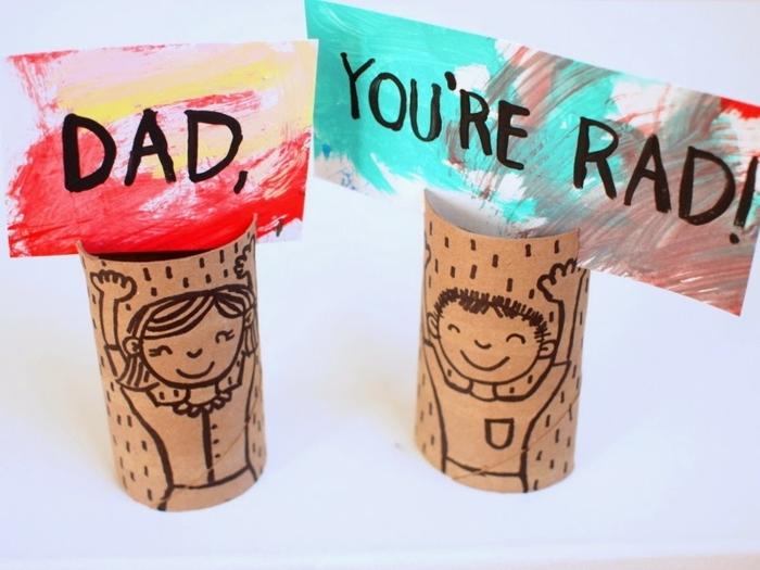 hermosas ideas de manualidades para el dia del padre, tubos de cartón dibujados con dibujos infantiles