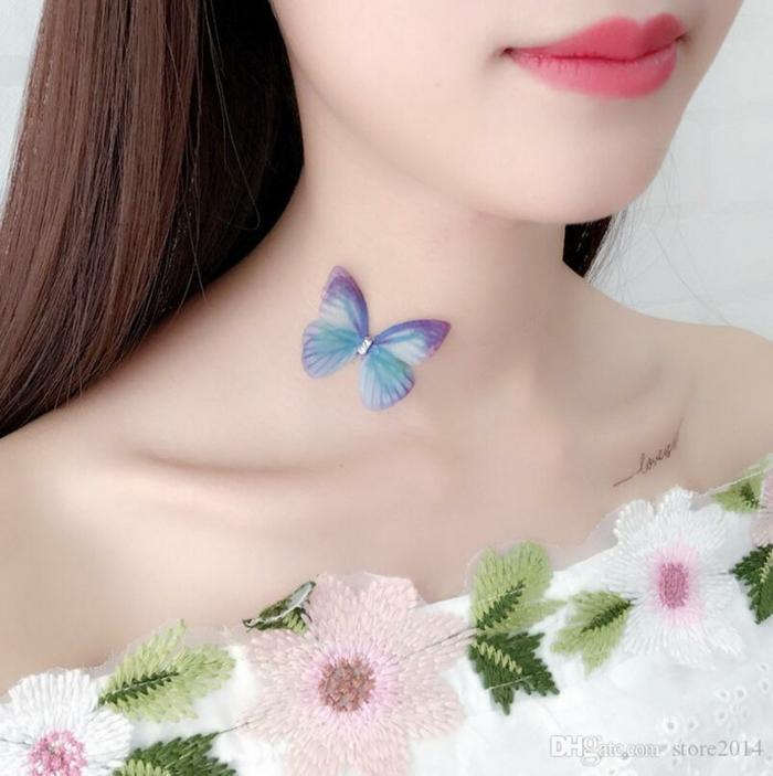 tatuajes delicados que significan transformación, tatuajes en la el cuello bonitos, pequeña mariposa en color azul
