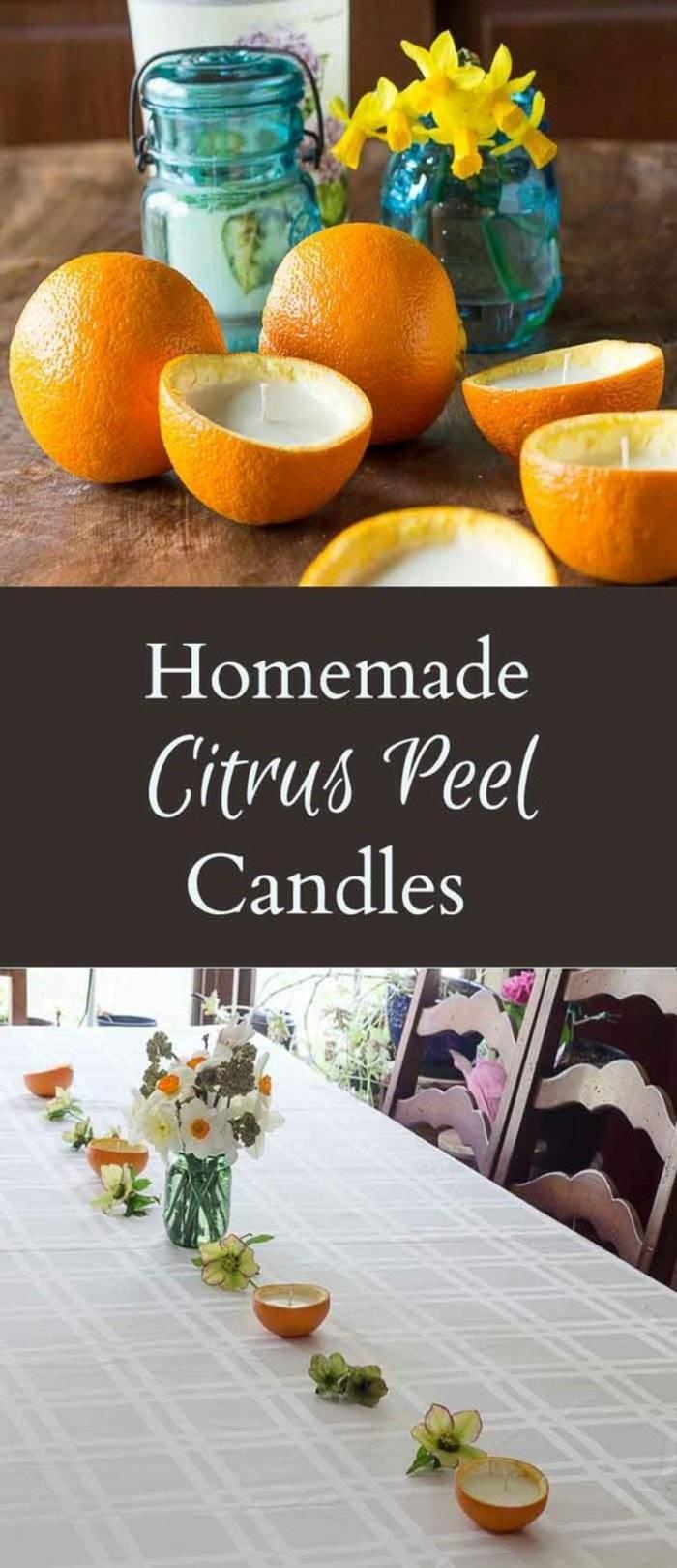 maravillosas ideas de centros de mesa DIY, centro de mesa con velas reutilizadas y naranjas