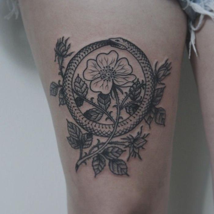diseños de tatuajes con elementos geométricos, serpiente en círculo y ramos de flores
