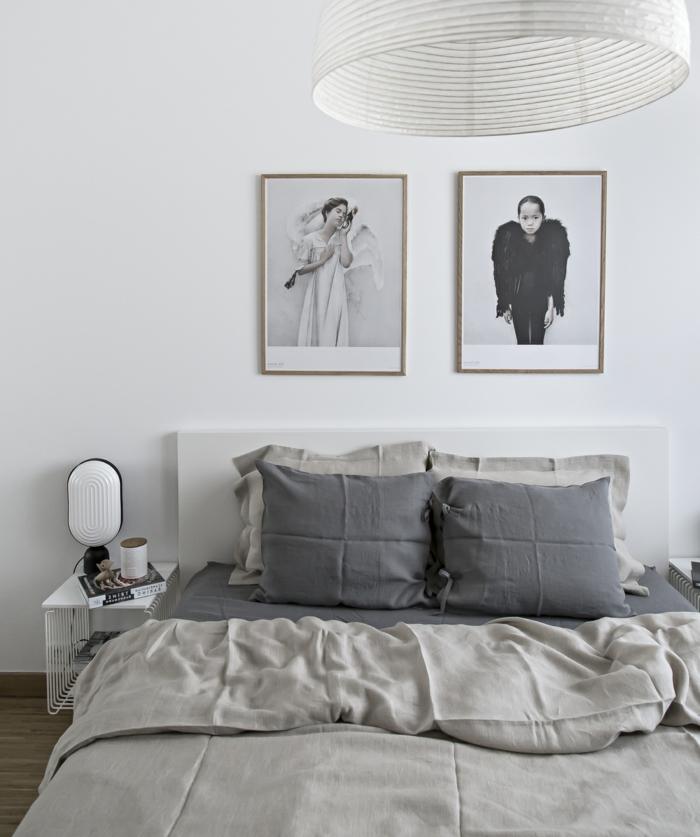 habitaciones matrimonio decoradas en blanco y gris, paredes decoradas de fotos en blanco y negro