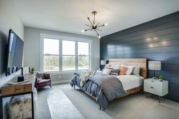 diseño dormitorio matrimonio moderno, paredes con vigas color azul y suelo de moqueta en gris