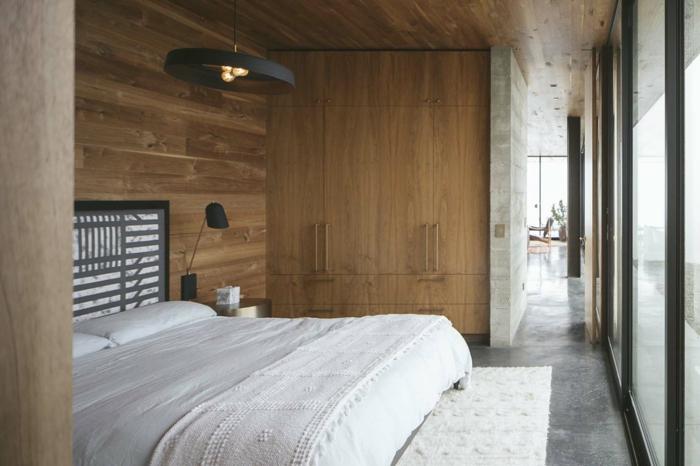 decoración dormitorio matrimonio blanco y madera, suelo de mármol, cama doble y grandes ventanales