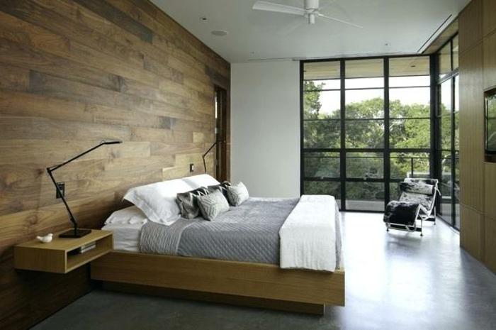 grande habitación con paredes de madera, cama doble y suelo en gris, decoración de habitaciones modernas