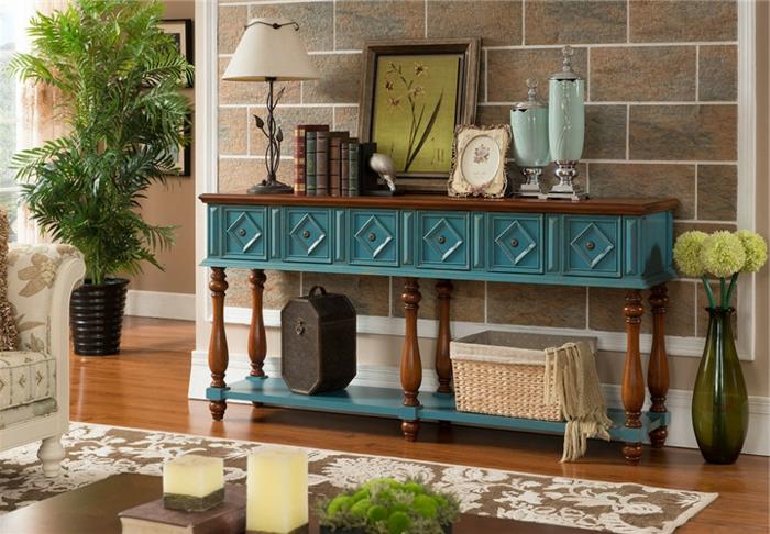 salón decorado en estilo moderno boho chic, colores terrestres oscuros, ideas como pintar un mueble de madera de otro color