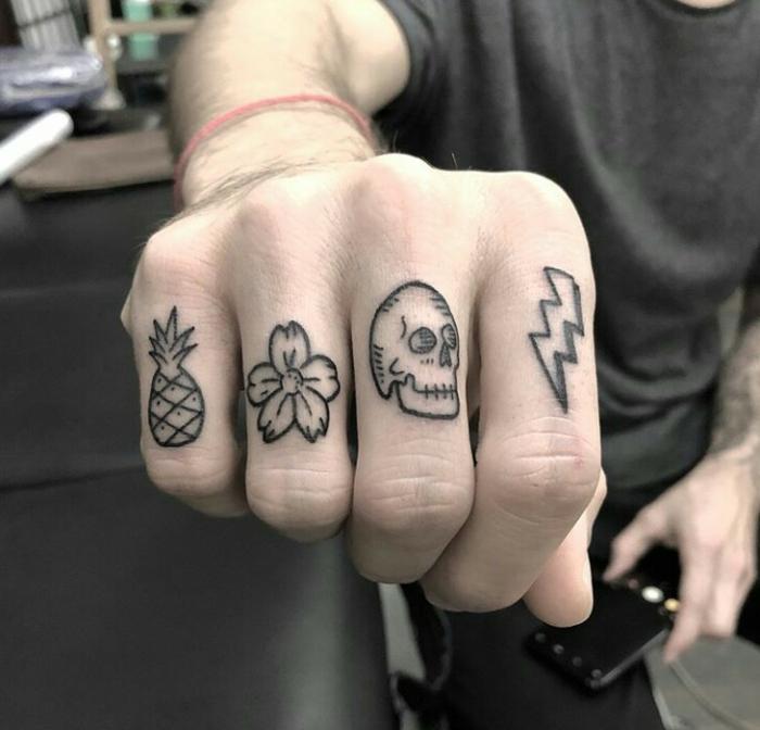 bonitos diseños de tatuajes en los nudillos, tatuajes en los dedos pequeños y simbólicos