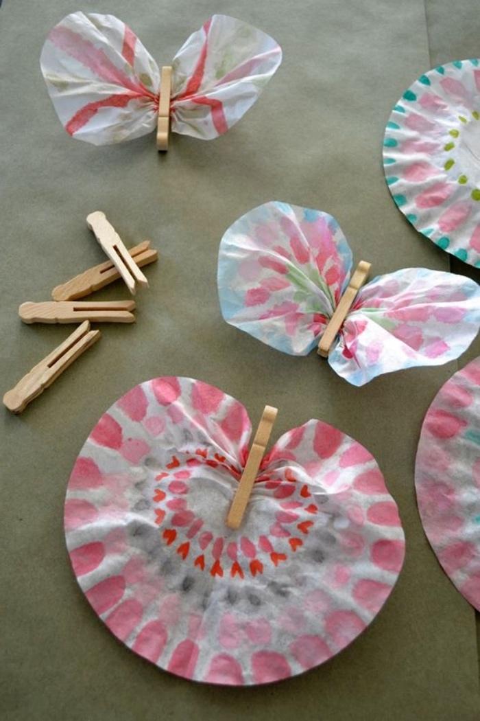 actividades de manualidades para niños de primaria, mariposas de papel reciclado bonitas, dieas sobre manualidades para niños de 3 a 5 años, mariposas de papel y pinzas de madera