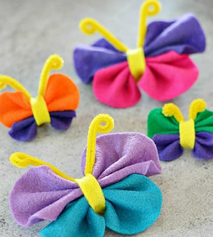 pequeñas mariposas hechas de fieltro en colores, manualidades para niños de 6 a 12 años, ideas de manualidades originales