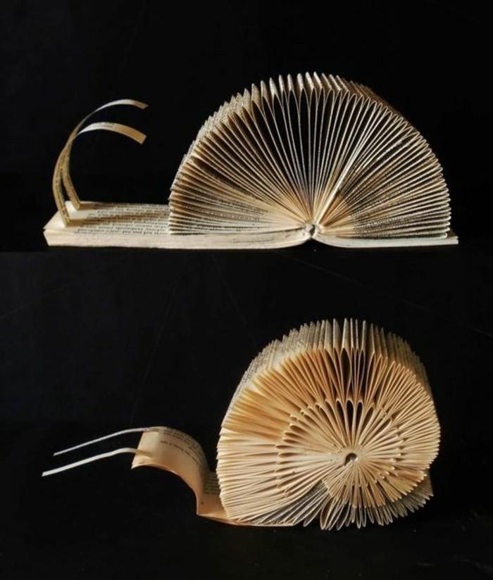 bonito caracol hecho con plegado de libros, inusuales ideas y detalles decorativos con la técnica de plegar páginas, libro de artista