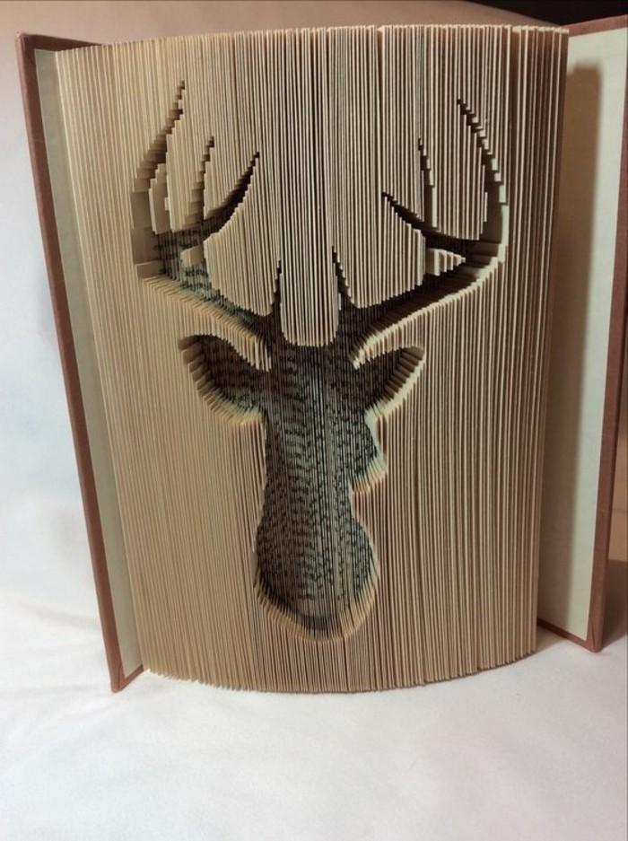precioso ciervo hecho con plegado de páginas, libro de artista paso a paso, videos con tutoriales de plegados de páginas artisticos