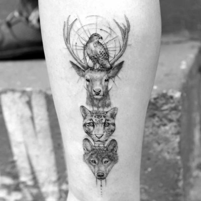 animales geométricos tatuados en la pantorrilla, lobo, tigre, ciervo y aguila, diseños de tattoos con animales salvajes