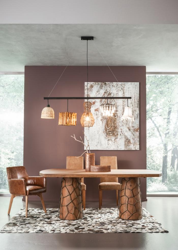 precioso salón decorado en estilo rústico moderno en tonos terrestres, lámparas colgantes modernas en el salón