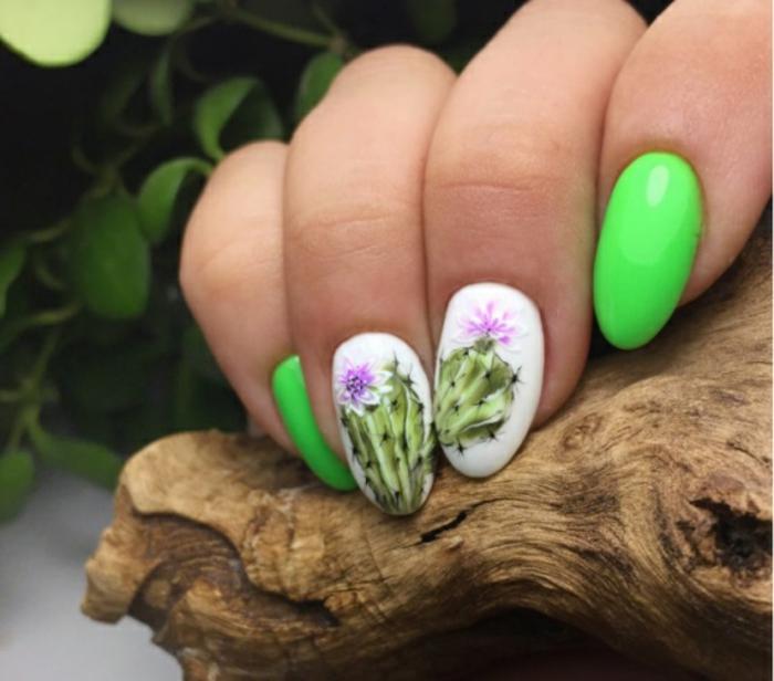 uñas con motivos botánicos, uñas con dibujos de cactus, uñas en verde neón y blanco, uñas veraniegas originales y frescas