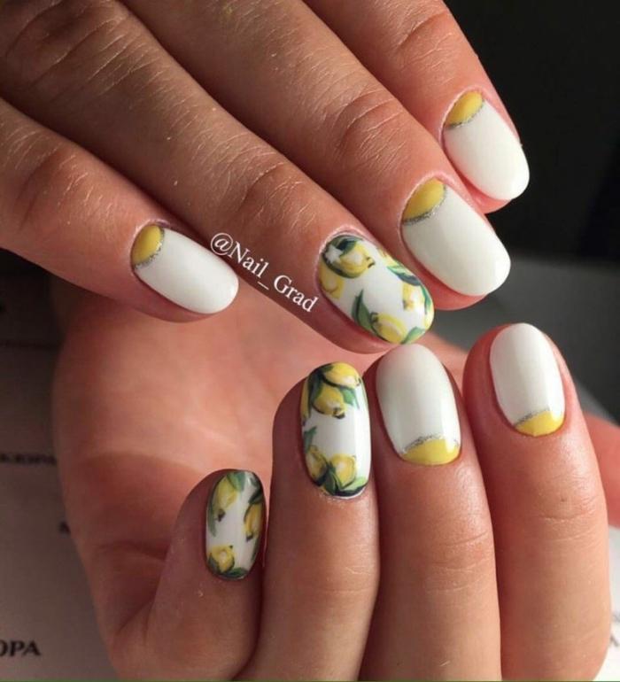 combinación de colores neones, blanco y motivos cítricos, dibujos de uñas de gel para el verano, uñas cortas pintadas en blanco con decorados
