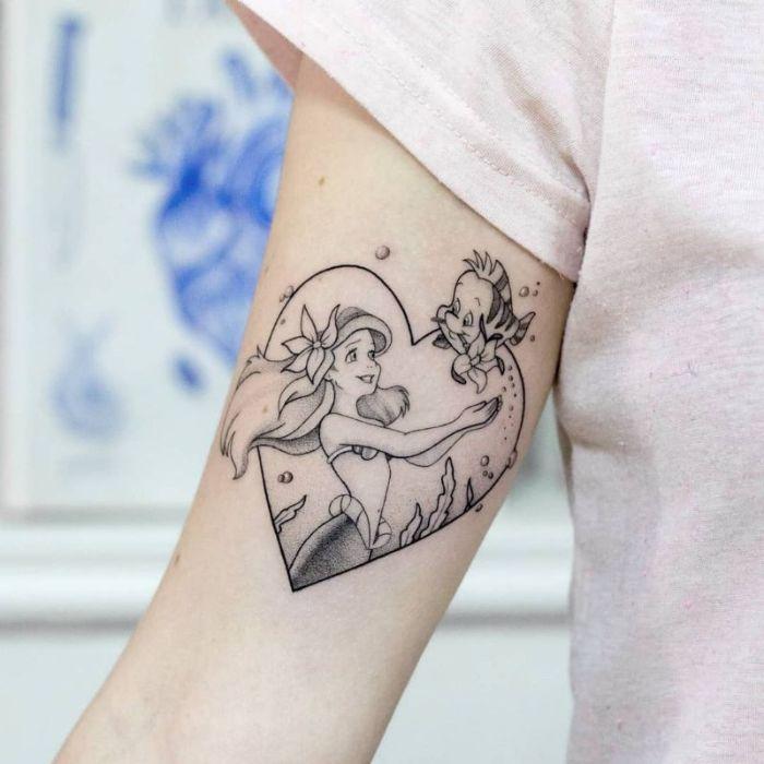 tatuajes Disney ideas en fotos, tatuaje corazón la Sirenita con Flounder, ideas y diseños de tatuajes para inspirarte