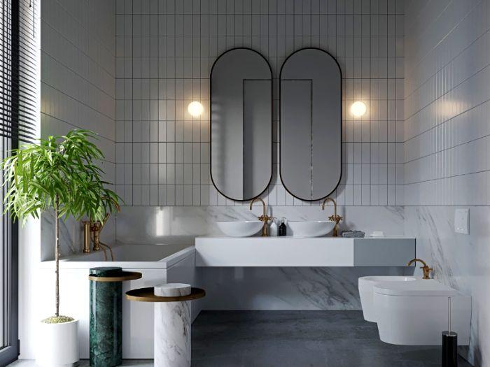 espacios decorados en estilo contemporáneo, baño en blanco y gris con dos espejos modernos de forma original y plantas verdes