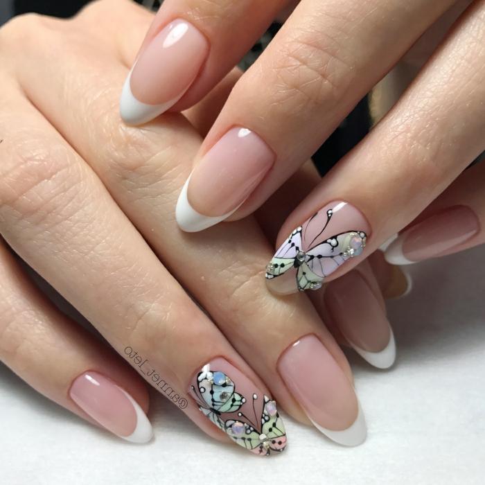 dibujos en las uñas bontios, uñas francesas con dibujos de mariposas, perlas y piedras decorativas, uñas decoradas