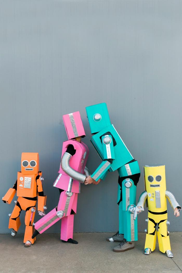 algunas ideas sobre disfraces en familia, disfraces hechos de cartón en diferentes colores, ejemplos de disfraces halloween grupo