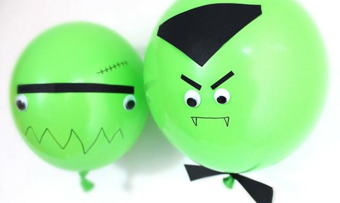 globos verdes decorados con caras de vampiros, manualidades halloween infantil super sencillas, fotos de motivos de Halloween