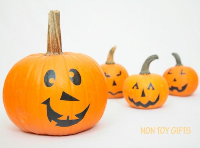 ideas clásicas de decoracion halloween manualidades, calabazas decoradas en estilo jack o lantern, ideas Halloween