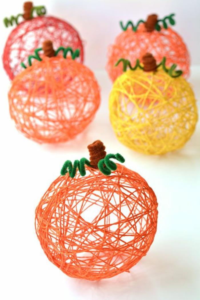 preciosos adornos de hilo hechos con globos, ideas de manualidades otoño para hacer en familia, proyectos decorativos DIY en fotos