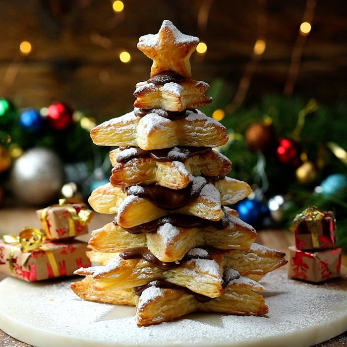 empanadas de hojaldre en forma de estrella huntadas con chocolate negro y azúcar glas, postres para impresionar a tus invitados