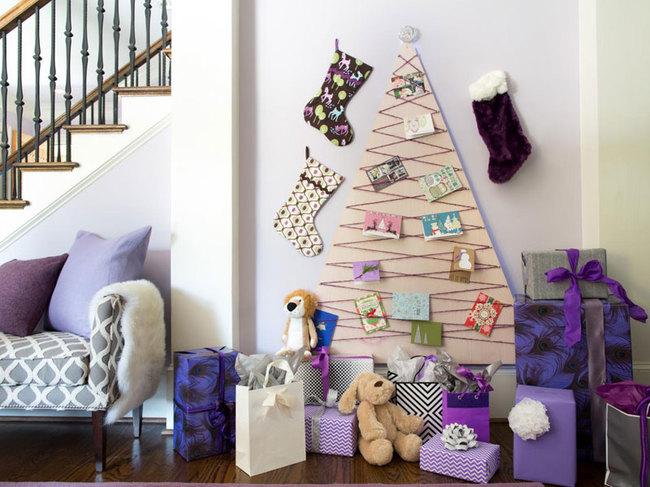 cuáles son las últimas tendencias en decoración navideña, como adornar un arbol de navidad alternativo, árbol navideño de cartón