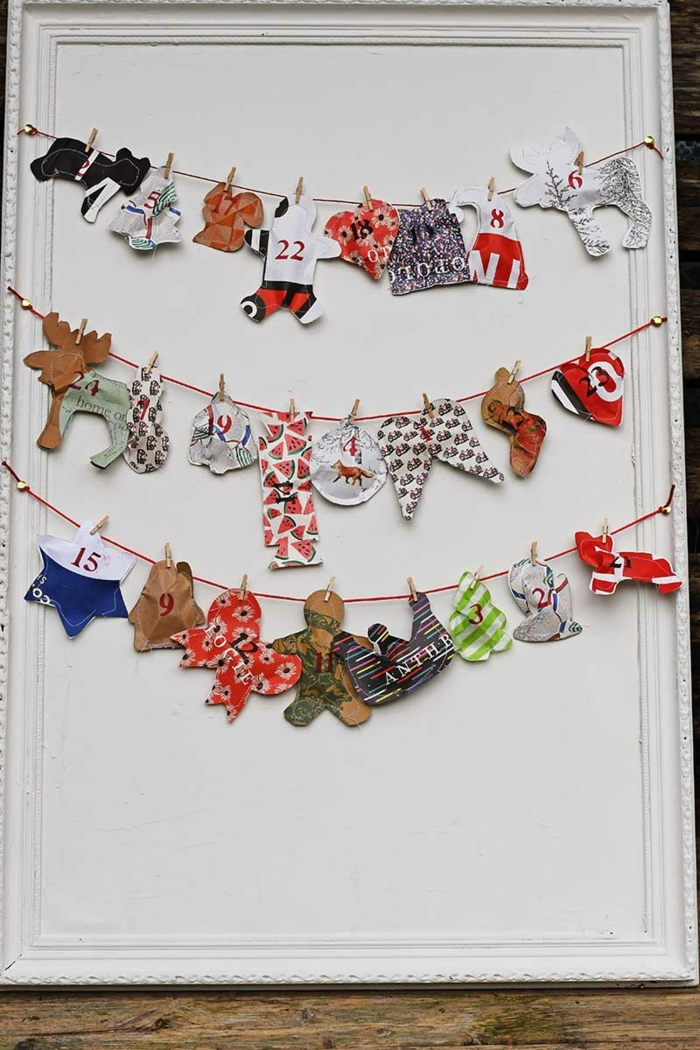manualidades para navidad originales, guirnalda de navidad de adornos navideños 3D hechos de papel reciclada