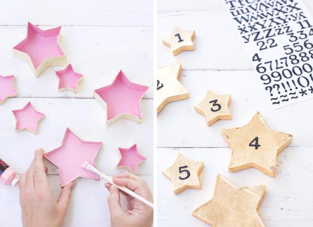 cajas de papel maché pintadas en rosado para hacer un calendario de adviento DIY, calendario de adviento para niños