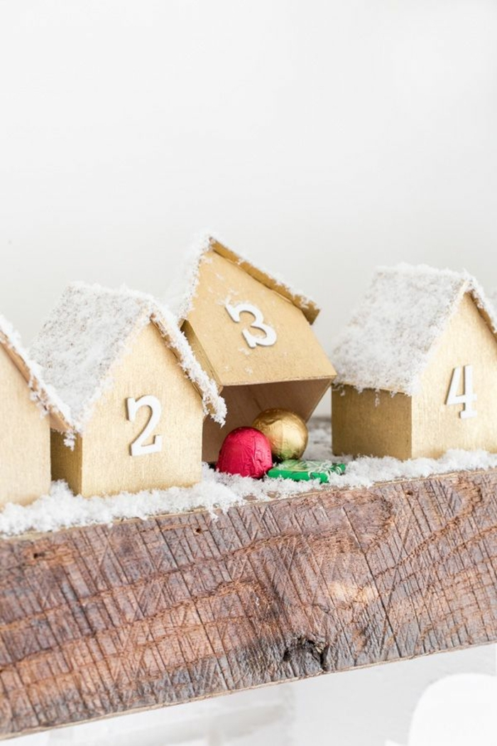 fantásticas ideas sobre como hacer un calendario de adviento para decorar la casa en navidad, cajas de cartón con efecto de nevado