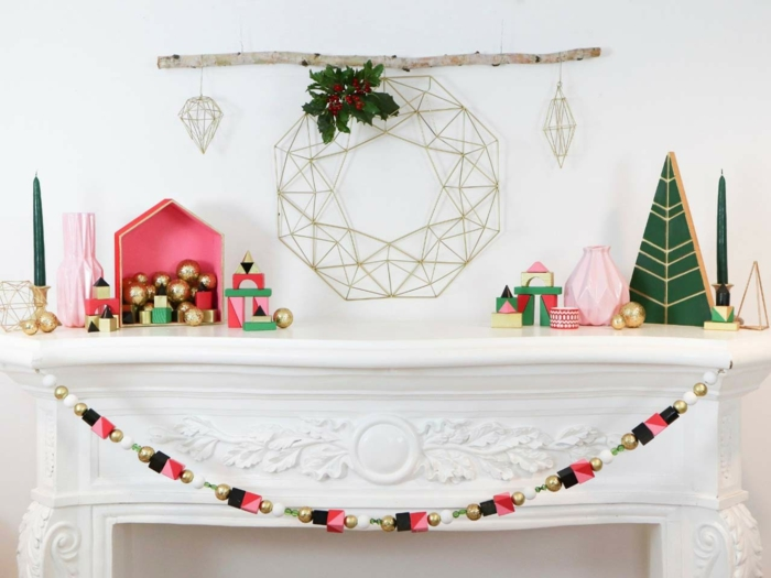 ideas de manualidades para navidad originales, guirnalda navideña de madera con detalles de madera geométricos