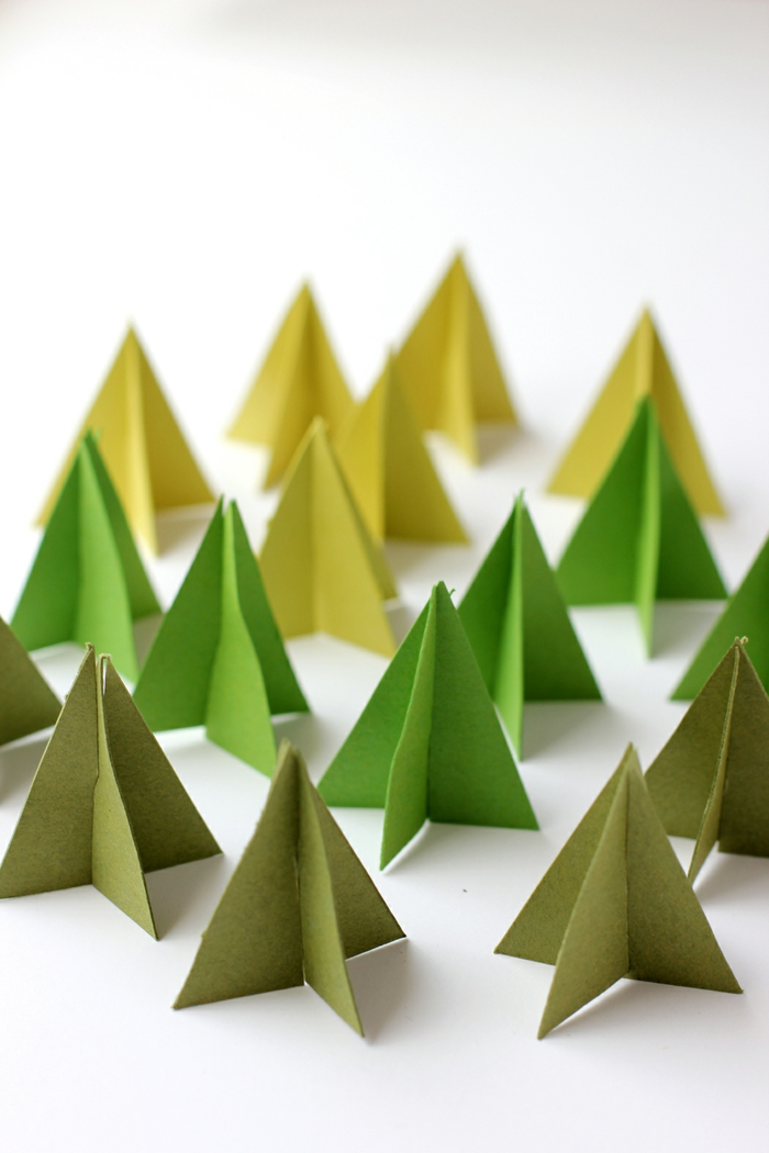 adornos navideños 3D hechos de cartulina, ideas para hacer adornos caseros bonitos, guirnaldas DIY para decorar la casa