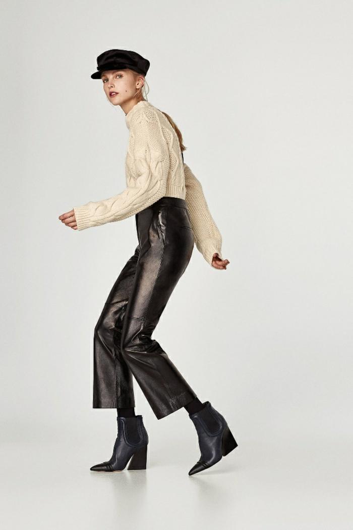 un look moderno y casual para una fiesta de Nochevieja en estilo urbano, pantalones de cuero color negro y jersey blanco