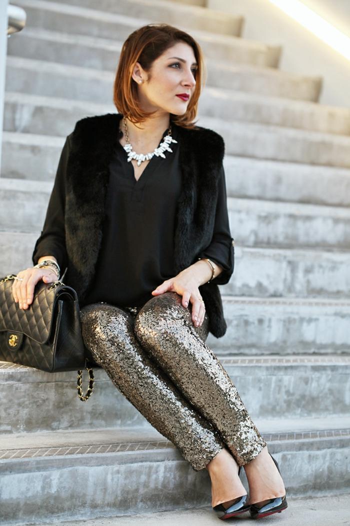 últimas tendencias en colores, tejidos y prendas en la moda femenina, atuendo elegante en negro y color plata con brillo