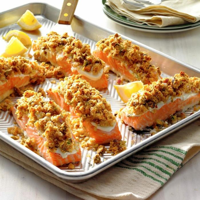 entrantes para Navidad y Nochevieja, pedazos de salmón al horno con nueces picados y limón, recetas para Nochevieja