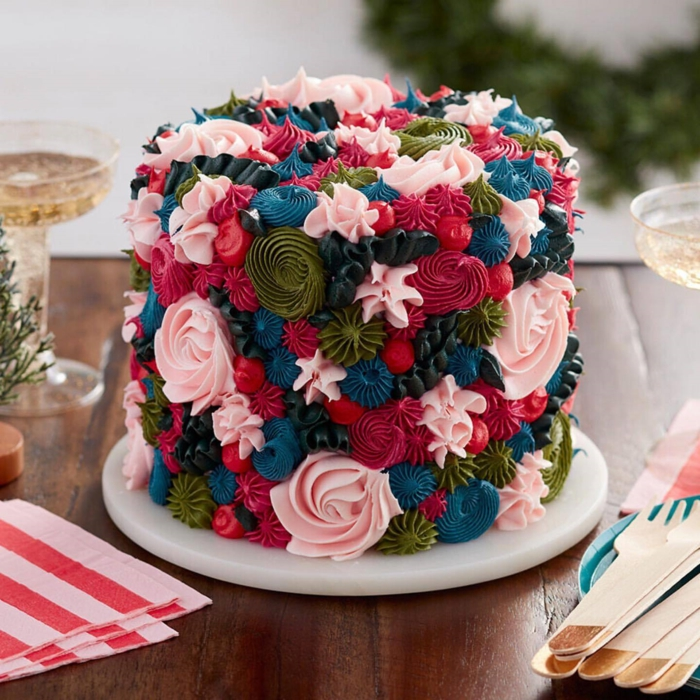 cake decorated with frosting flowers in different colors, food coloring in contrasting tones, easy and pretty birthday cake