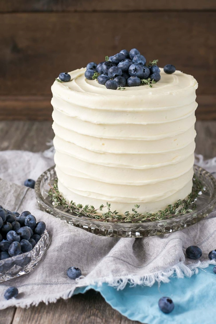 large cake with white frosting and fresh blueberries, best cakes for a birthday, custom cakes