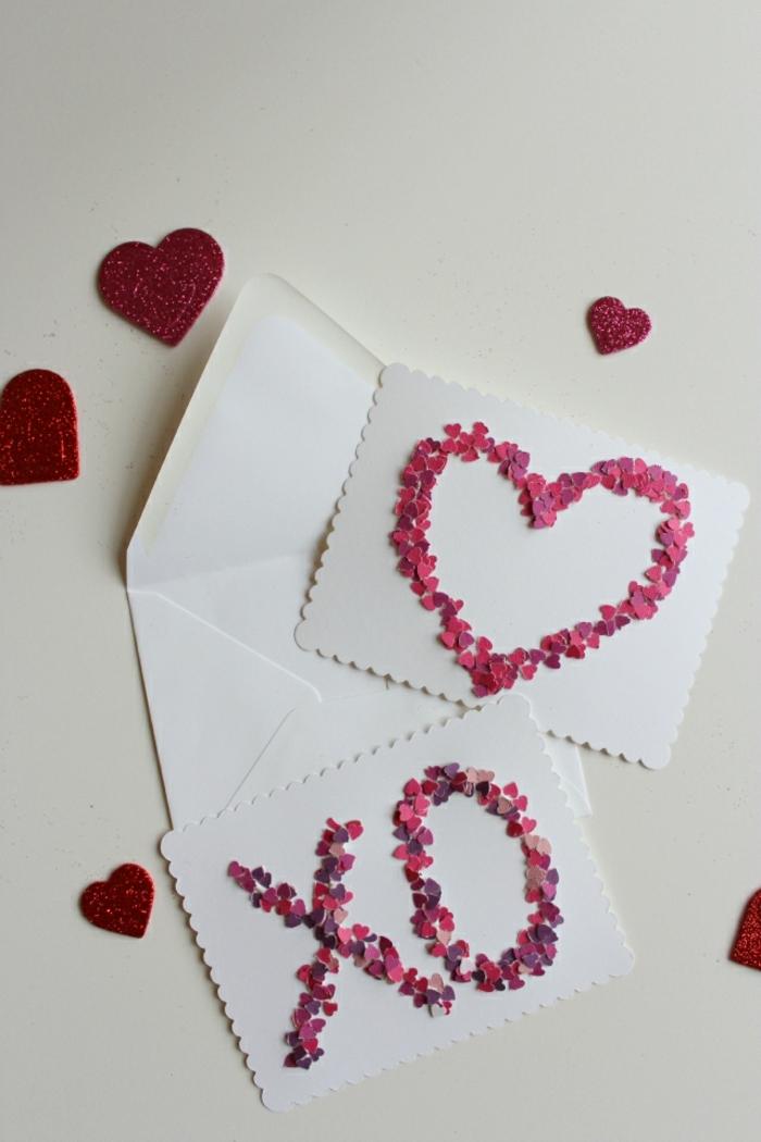 tarjetas san valentin con confetti en forma de corazones en diferentes tonos del color rosado y lila, tarjetas con confetti