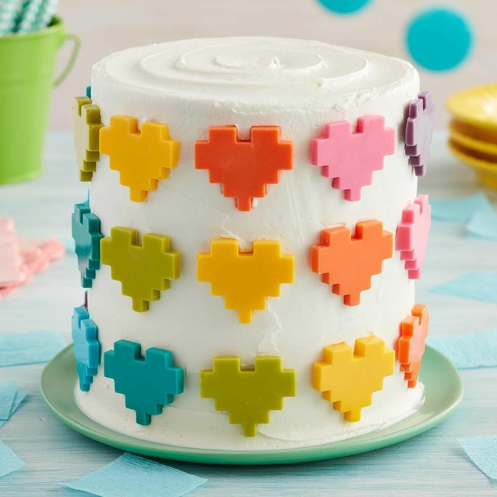 cake decoration for Valentine's Day, cake ideas for special occasions, sugar hearts in different colors