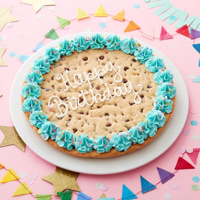 original cakes and pies to make at home, happy birthday cake, large chocolate chip cookie decorated with blue sugar sighs