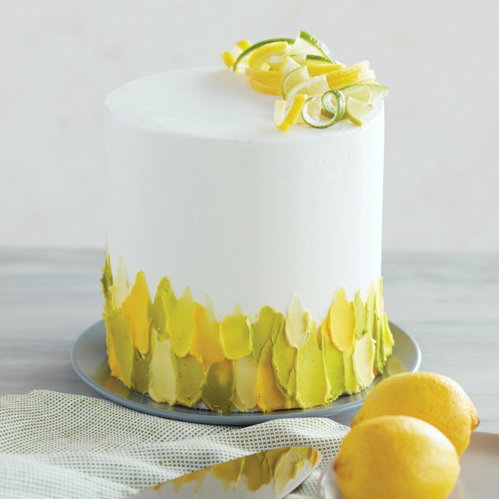 white icing cake with yellow and green decoration, super simple techniques to decorate a cake, photos of cakes