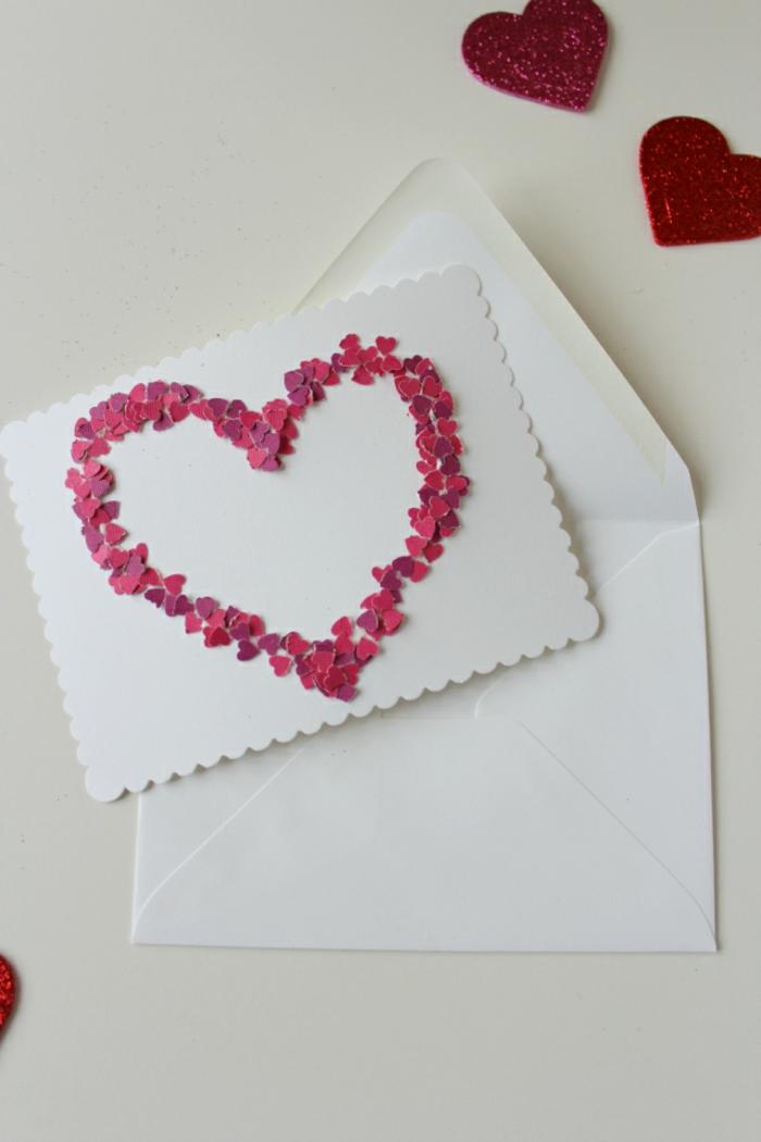 las mejores ideas de tarjetas temáticas para el Día de San Valentín, grande corazón hecho de pequeños confetti en forma de corazon