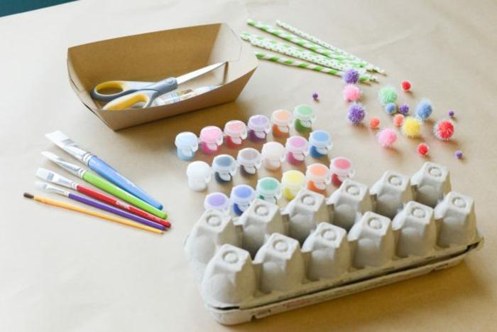 lo que necesitas para hacer molinillos de viento de cartón, pinturas en diferentes colores, cartón de huevos, manualidades con carton de huevo