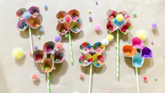 molinillos de viento coloridos hechos de cart'on reciclado, ideas de manualidades con carton de huevo para hacer con tus niños