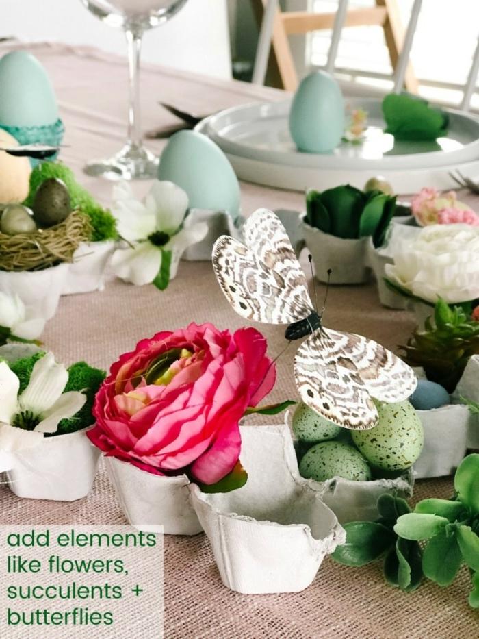 centro de mesa con detalles decorativos de pascua y hueveras recicladas, manualidades originales para decorar la mesa