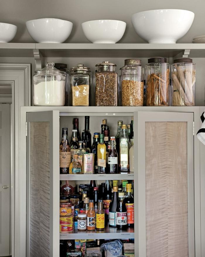 ideas de almacenaje en casa, organizador cajones cocina, fotos de cocinas limpias y bien organizadas, frascos de cristal grande