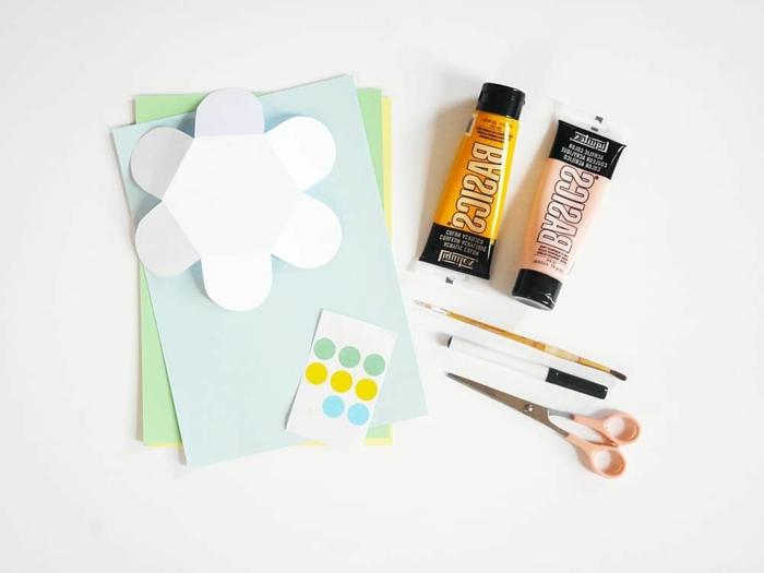 materiales necesarios para hacer flores de papel 3d, tijeras, lapiz, hojas de papel coloridos, ideas de manualidades infantiles